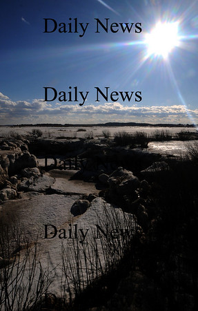 Newbury: The bright sun Sunday helps melt the tide water along teh Plum Island Turnpike.photo by Jim Vaiknoras/Newburyport Daily News. Feburary 7, 2009