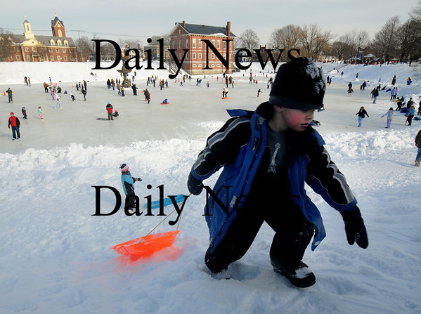Newburyport: Camdon Kelewae, 5, makes it to the top of the hill before going on another sled run  at the Newburyport Winter Carnival at the Mall Saturday. photo by Jim Vaiknoras/Newburyport Daily News. February 7, 2009