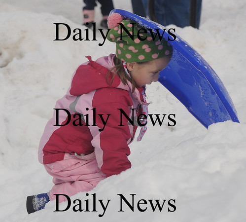 Newburyport: Megan Kempton, 6, of Newburyport takes a rest as she climbs back up the hill while sledding  at the Newburyport Winter Carnival at the Mall Saturday. photo by Jim Vaiknoras/Newburyport Daily News. February 7, 2009