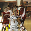 Newburyport:Amesbury's Stephan Deas layes the ball in against  Newburyport during their game at Newburyport Friday night. photo by Jim Vaiknoras February 13, 2009