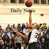 Amesbury: Pentucket's Emily Lane with an acrobatic shot during the Sachem's 72-24 victory over Pope John Friday night at Amesbury. photo by Jim Vaiknoras/Newburyport Daily News. Friday February 27, 2009