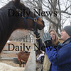 Newbury: Phillip Kaneb and Debbie Cartier greet Molly during a weekly visit to the Spencer-Pierce-Little Farm Wednesday. The program brings special need students to the farm to help out and learn about working on the farm.photo by Jim Vaiknoras Newburyport Daily News. Wednesday February, 25, 2009