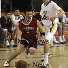 Newburyport:Amesbury's Jared Flannigan drives by  Newburyport's Bruce Pollard during their game at Newburyport Friday night. photo by Jim Vaiknoras February 13, 2009