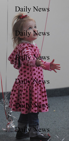 Newburyport: Amber Rothbery, 2, plays with some of the balloon strings at the Newburyport Mother Club  Valentine's dance is at the Hope Church this Saturday. photo by Jim Vaiknoras/Newburyport Daily News. Feburary 7, 2009