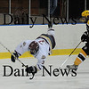 Salem: Newburyport's Kyle McElroy is tripped by  Bishop Fenwick's Tyler Burgess during the Cippers 4-3 victory Tuesday night at Salem State College. photo by Jim Vaiknoras