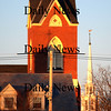 Newburyport: The steeples of the Immaculate Conception and Uniterian Churchs glow in the late afternoon sunshine. photo by Jim Vaiknoras /Newburyport Daily News. February 15, 2009