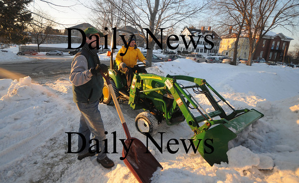 Newburyport: Scott Hilton, on tractor, and Bob Uhlig work on the snowboard hill for the Newburyport Winter at the Mall late Friday afternoon. photo by Jim Vaiknoras/Newburyport Daily News February 6, 2009