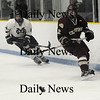 Malden:Newburyport's William Boudreau clears the puck as  Malden Catholic player move in during their game at Malden Saturday.photo by Jim Vaiknoras/Newburyport Daily News. Feburary 7, 2009