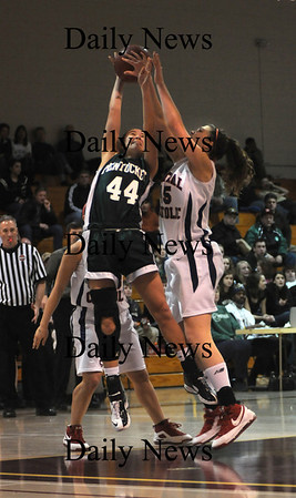 Boston: Pentucket's Andrea Attenasio fights for a rebound with   Central Catholic's Katie Zenevitch during the Sachems 51-48 loss Sunday to in the 19th annual Comcast Tournament at Boston Collage High.photo by Jim Vaiknoras/Newburyport Daily News. February 15, 2009.