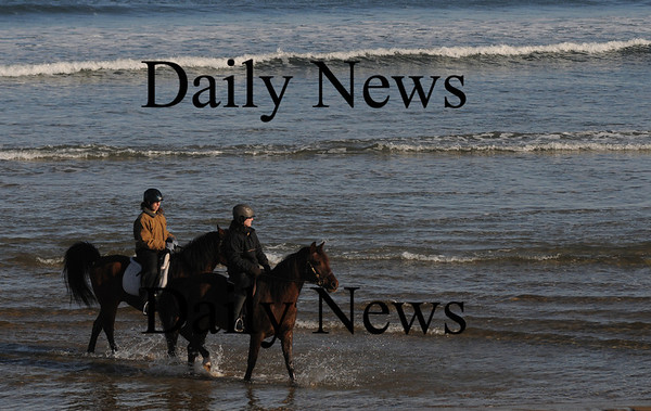 Salisbury: Two equestrians slash their way along Salisbury Beach Saturday afternoon.photo by Jim Vaiknoras/Newburyport Daily News February 22, 2009