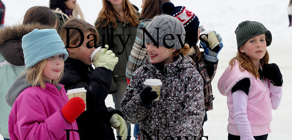 Newburyport:Hot chocolate helped warm the day  at the Newburyport Winter Carnival at the Mall Saturday. photo by Jim Vaiknoras/Newburyport Daily News. February 7, 2009