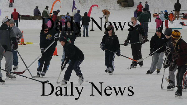 Newburyport:Hockey was just one of the events on the Frog Pond at the Newburyport Winter Carnival at the Mall Saturday. photo by Jim Vaiknoras/Newburyport Daily News. February 7, 2009