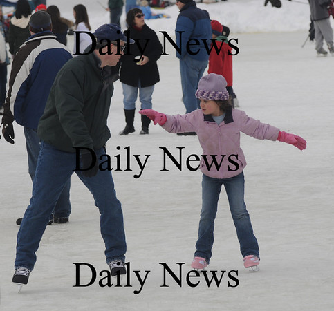 Newburyport: Anna Doucette, 7, gets a skating leason from her dad Armand at the Newburyport Winter Carnival at the Mall Saturday. photo by Jim Vaiknoras/Newburyport Daily News. February 7, 2009