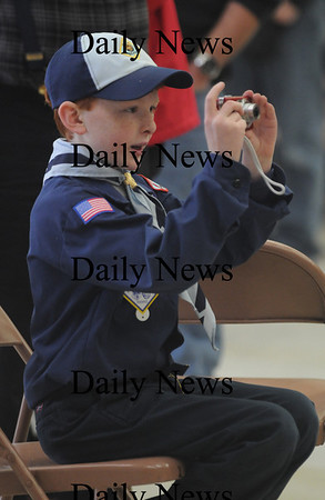 Merrimac:Brian Marden snaps a photo of the Pack 14 Pinewood Derby Saturday at the Sweetsir School. photo by Jim Vaiknoras/Newburyport Dailynews. February 7, 2009