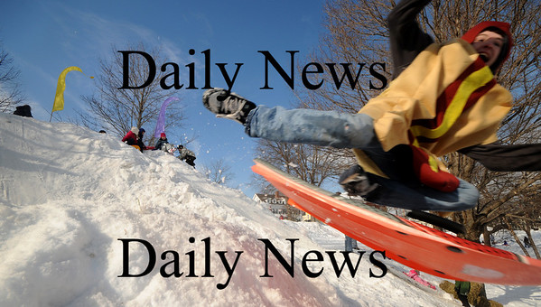 Newburyport: Dan Spencer, dressed as a hot dog, flies over on of the many sled runs at the Newburyport Winter Carnival at the Mall Saturday. photo by Jim Vaiknoras/Newburyport Daily News. February 7, 2009