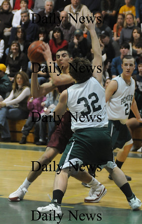 West Newbury:  Newburyport's Thomas Morris makes a move on Pentucket's Cam Spofford during their game at West Newbury Friday night.photo by Jim Vaiknoras/ Newburyport Daily News. February 6 2009