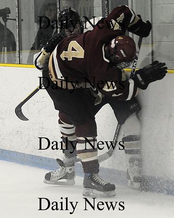 Malden:Newburyport's Zachary Schmeller checks a Malden Catholic player during their game at Malden Saturday.photo by Jim Vaiknoras/Newburyport Daily News. Feburary 7, 2009