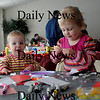 Newburyport: Dylan Davis, 4, and her little sister Devon make cards at the Newburyport Mother Club  Valentine's dance is at the Hope Church this Saturday. photo by Jim Vaiknoras/Newburyport Daily News. Feburary 7, 2009