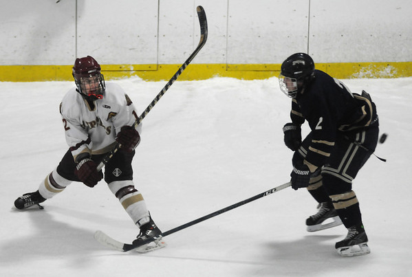 Newburyport: Newburyport's Collin Cusack clears the puck past a St Mary's player during their game Tuesday night at the Graf Rink. photo by Jim Vaiknoras/Newburyport News. Tuesday February, 17, 2009