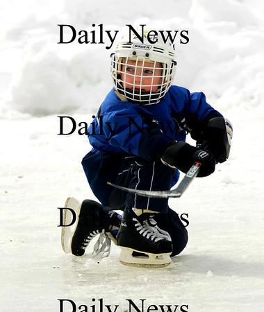 Newburyport: Zach Raposa, 5, of Newburyport plays a little hockey at the Newburyport Winter Carnival at the Mall Saturday. photo by Jim Vaiknoras/Newburyport Daily News. February 7, 2009