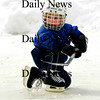 Newburyport: Zach Raposa, 5, of Newburyport plays a little hockey at the Newburyport Winter Carnival at the Mall Saturday. photo by Jim Vaiknoras/Newburyport Daily News. February 7, 2009
