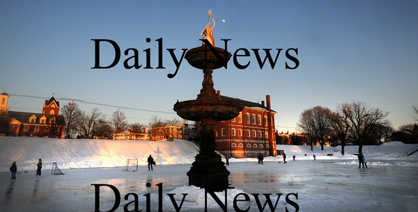 Newburyport: The waxing moon rises behind the Swan Statue on the Frog Pond in the Mall late Friday afternoon. photo by Jim Vaiknoras/Newburyport Daily News February 6, 2009