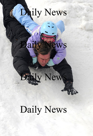 Newburyport: Lana Mickelson holds on as her dad Stone slides on his belly down one of the sledding hills at the Newburyport Winter Carnival at the Mall Saturday. photo by Jim Vaiknoras/Newburyport Daily News. February 7, 2009