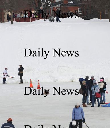 Newburyport: The Kimball Farm Hay Ride makes it's way past skaters at the Newburyport Winter Carnival at the Mall Saturday. photo by Jim Vaiknoras/Newburyport Daily News. February 7, 2009