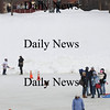 Newburyport: The Kimball Farm Hay Ride makes it's way past skaters at the Newburyport Winter Carnival at the Mall Saturday. photo by Jim Vaiknoras/Newburyport Daily News. February 7, 2009