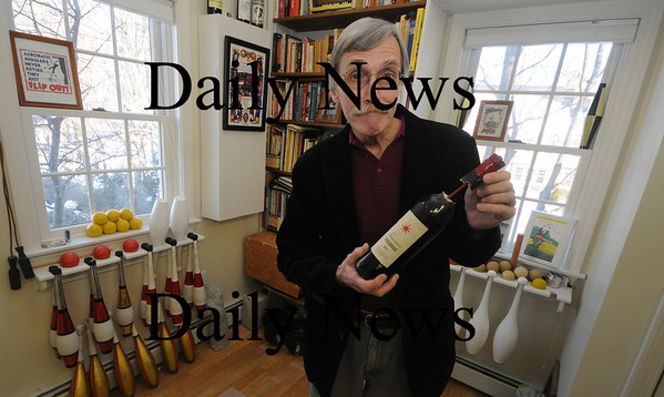 Newburyport: Reg Bacon at his Newburyport home with one of the prop bottles he used in the movie Pink Panther 2. photo by Jim Vaiknoras/ Newburyport Daily News. February 6 2009