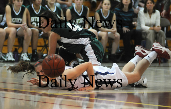 Boston: Pentucket's Andrea Attenasio collides with Central Catholics Kendall Desrosiers while going for a loose ball during the Sachems 51-48 loss Sunday in the 19th annual Comcast Tournament at Boston Collage High.photo by Jim Vaiknoras/Newburyport Daily News. February 15, 2009.