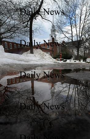 Newburyport: The Uniterian Church is reflected in the melting snow on Inn Street Sunday .photo by Jim Vaiknoras/Newburyport Daily News. Feburary 7, 2009