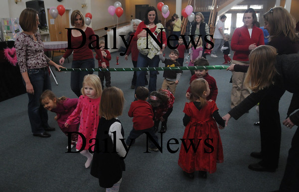 Newburyport: Kids and parents Limbo at the Newburyport Mother Club  Valentine's dance is at the Hope Church this Saturday. photo by Jim Vaiknoras/Newburyport Daily News. Feburary 7, 2009
