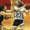 Amesbury: Pentucket's Holly Jakobsons looks for some one to pass to during the Sachem's 72-24 victory over Pope John Friday night at Amesbury. photo by Jim Vaiknoras/Newburyport Daily News. Friday February 27, 2009