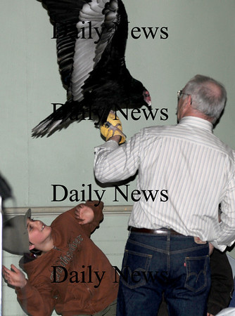 Newburyport:Eli Giordan, 9, of Newburyport reacts as Tom Ricardi holds a bald eagle turkey vulture of the 4th annual Newburyport Eagle Festival photo by Jim Vaiknoras/Newburyport Daily News. February 14, 2009