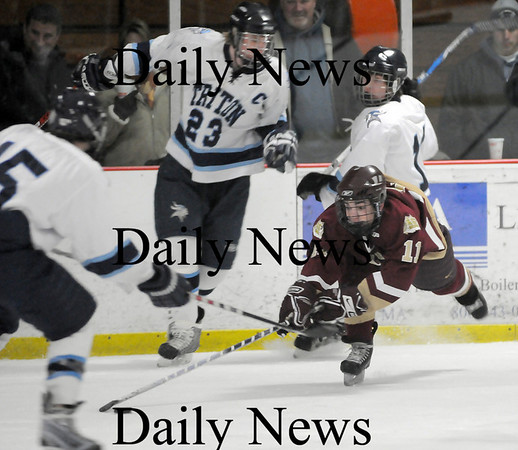 Newburyport: Ryan Cutter (11) of Newburyport tries to keep his feet underneath him as the Triton defense closes in. The Clippers won this seasons rematch 6-0 at the Graf Rink. Photo by Ben Laing/Newburyport Daily News Saturday January 17, 2009.