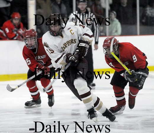 Newburyport: Clippers captain Kevin Holmes (19) slips past the Amesbury defense during last nights 3-1 win. Photo by Ben Laing/Newburyport Daily News Wednesday January 14, 2009.