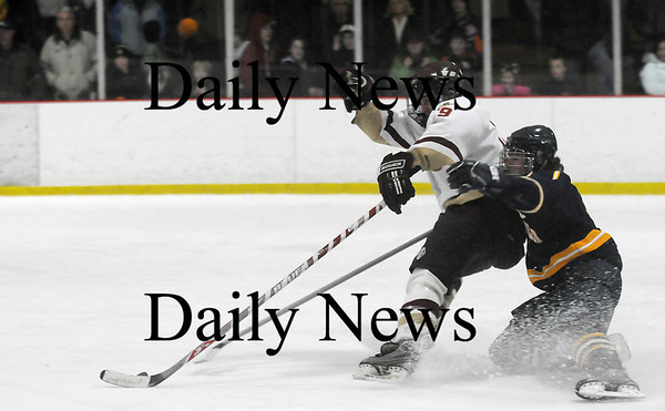 Newburyport: Clipper captain Kevin Holmes (19) can't shake a Lynnfield defender on a break away attempt in Saturday night's 2-2 tie at the Graf Rink. Photo by Ben Laing/Newburyport Daily News Saturday January 31, 2009.