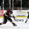 Newburyport: Senior Kevin Holmes (19) of Newburyport takes a shot early in the first period of Saturday nights 6-0 win over Triton at the Graf Rink. Photo by Ben Laing/Newburyport Daily News Saturday January 17, 2009.