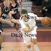 Newburyport: Clipper guard Matt Leavitt (3) drives past a Rockport defender during Wednesday's game at Newburyport High School. Photo by Ben Laing/Newburyport Daily News Wednesday January 7, 2009.