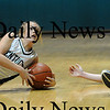 West Newbury: Pentucket's Emily Lane (3) and Ipswich's Amber Smith (30) look to the referee to see who one possesion as both dove to the floor for a loose ball during Tuesday night's game in West Newbury. Photo by Ben Laing/Newburyport Daily News Tuesday January 20, 2009.