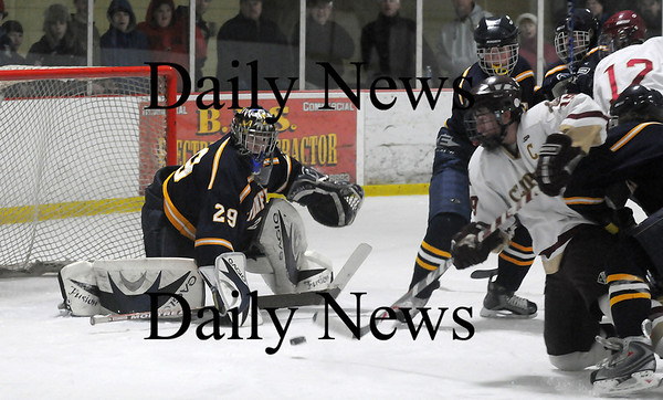 Newburyport: Senior captain Kevin Holmes (19) takes a shot from his knees on Lynnfield's goalie Craig Cataldo (29) during Newburyport's 2-2 tie Saturday night. Photo by Ben Laing/Newburyport Daily News Saturday January 31, 2009.