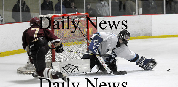 Newburyport: Triton goalie Matt Beevers (30) stretches to controll a shot from Newburyprot's Gavin LaValley (7) during the Clipper's 6-0 win at the Graf Rink. Photo by Ben Laing/Newburyport Daily News Saturday January 17, 2009.
