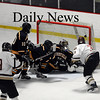 Newburyport: Trailing 2-1 with roughly 30 seconds to play, Newburyport's Kyle McElroy (3) was in the perfect position to lift the puck past Lynnfield's Craig Cataldo (29) for the equalizer. Photo by Ben Laing/Newburyport Daily News Saturday January 31, 2009.