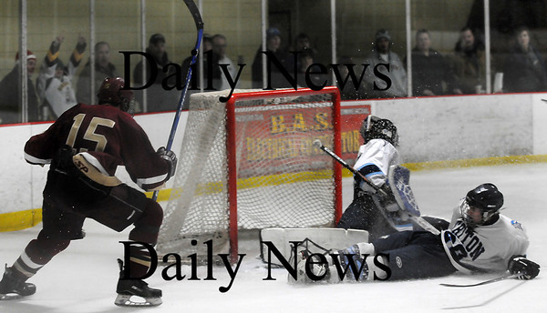 Newburyport: Newburyport's Corey Ruane (15) puts the puck in the net late in the third period as the Clippers rolled over Triton, 6-0 at the Graf Rink. Photo by Ben Laing/Newburyport Daily News Saturday January 17, 2009.