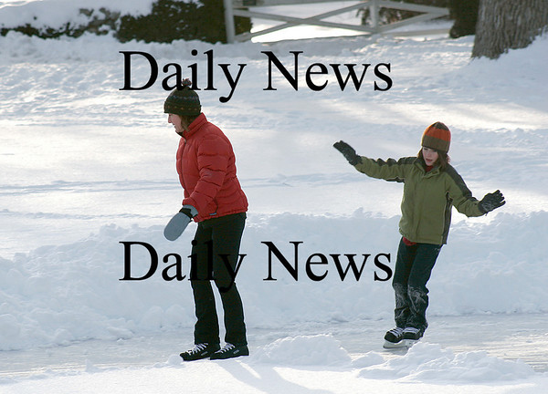 Newbury: Benen Weir and his mom Jennie Lee of Newburyport, spend Wednesday afternoon ice skating on the Upper Green in Newbury. Photo by Ben Laing/Newburyport Daily News Wednesday January 14, 2009.