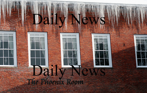 Newburyport: Icicles stretch down from the rooftops along Inn Street. Photo by Ben Laing/Newburyport Daily News Tuesday January 20, 2009.