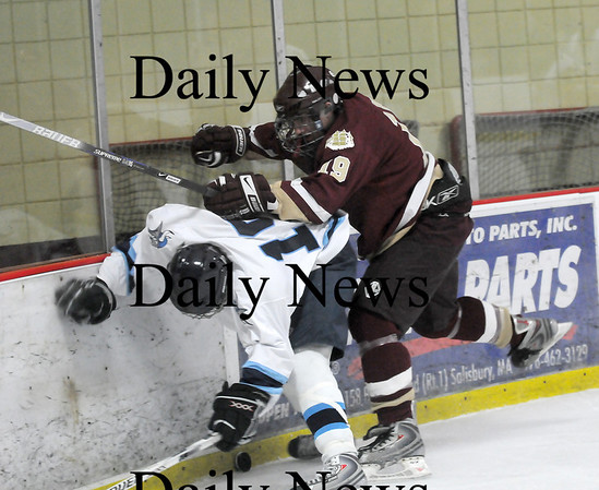 Newburyport: Newburyport's Kevin Holmes (19) lays a hit on a Triton player during Saturday nights 6-0 win at the Graf Rink. Photo by Ben Laing/Newburyport Daily News Saturday January 17, 2009.