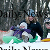 Newburyport: Christine Mead and her two children, Morgan, left and Tegan, right, wait for traffic to clear before racing down March's Hill in Newburyport Thursday. Photo by Ben Laing/Newburyport Daily News Thursday January 8, 2009.
