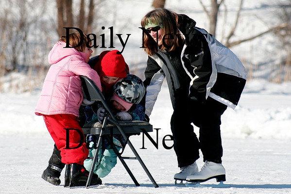 West Newbury: Lynn Smith (right) pulls Sarah Graninger (left), Christian Gretz, (red hat) and Sage Smith (middle) across Mill Pond on their skates in West Newbury Monday afternoon. Photo by Ben Laing/Newburyport Daily News Monday January 26, 2009.